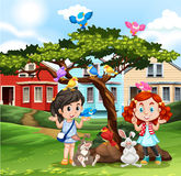 Girls playing with animals outside Royalty Free Stock Photo