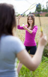 Girls playing badminton Stock Photography