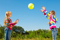 Girls playing with the ball. Two girls playing with the ball Stock Images