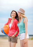 Girls playing ball on the beach Stock Image