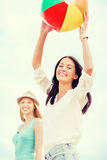 Girls playing ball on the beach Stock Photography
