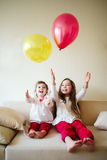 Girls playing with balloons at home Stock Photography