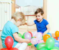 Girls playing with  balloons Stock Photo