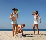Girls playing on the beach stock images