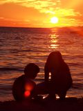 Girls playing on beach. In sunset royalty free stock images