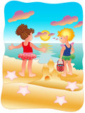 Girls playing on the beach Stock Image