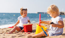 Girls playing on  beach Stock Images
