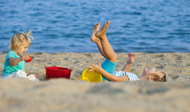 Girls playing on the beach Royalty Free Stock Images