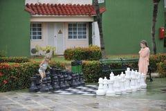 Girls playing big chess. Stock Photography