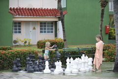 Girls playing big chess. Stock Photo