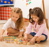 Girls playing with blocks Royalty Free Stock Photo