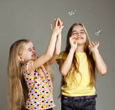 Girls playing bubbles Stock Image