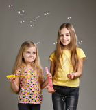 Girls playing bubbles Royalty Free Stock Photography