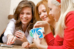 Girls playing cards Stock Photography
