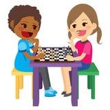 Girls Playing Chess. Two cute little girls playing chess having fun Royalty Free Stock Photos