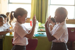 Girls playing clapping game Stock Photo
