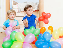 Girls playing with colorful balloons Stock Image