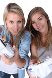 Girls playing computer games Stock Images