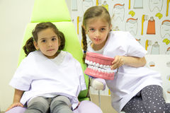 Girls playing at the dentist Royalty Free Stock Photos