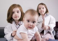 Girls playing doctor Stock Photography