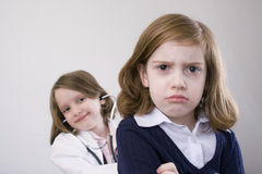 Girls playing doctor royalty free stock photography