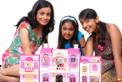 Girls playing with doll house Stock Photo
