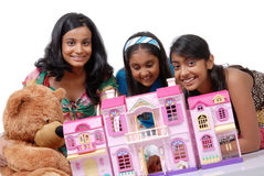 Girls playing with doll house Royalty Free Stock Image