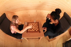 Girls playing draughts Royalty Free Stock Photo