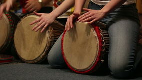 Girls playing on ethnic drums djembe stock video