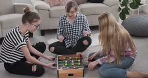 Girls playing foosball at home. Excited teenage girls playing foosball at home stock footage