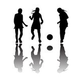 Girls playing football. Black silhouettes isolated on white background; vector art illustration; more drawings in my gallery Stock Photos
