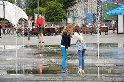 Girls playing at the fountain Royalty Free Stock Photo