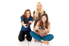 Girls playing games. Girls play video games isolated Stock Image