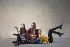Girls playing the guitar royalty free stock photo