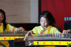 Girls in playing the guzheng Stock Photography