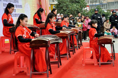 Girls Playing Guzheng on Lantern Festival. The Guzheng is a traditional Chinese plucked zither which has 18 or more strings and movable bridges Royalty Free Stock Photos