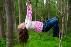 Girls playing hanging in lianas at the jungle park Stock Image