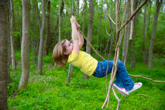 Girls playing hanging in lianas at the jungle park Stock Photography