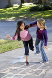 Girls playing hopscotch Royalty Free Stock Images