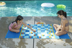 Girls Playing Large Draughts Board Royalty Free Stock Photography