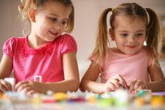 Girls playing at home. Portrait. stock image