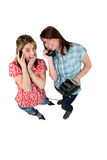 Girls playing with old phone Stock Image
