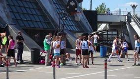 Girls playing outdoor street basketball tournament 3x3