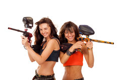 Girls playing paintball. Two young beautiful girls posing like playing paintball Stock Photo