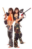 Girls playing paintball. Two young beautiful girls posing like playing paintball Royalty Free Stock Photo