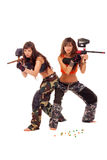 Girls playing paintball. Two young beautiful girls posing like playing paintball Royalty Free Stock Images
