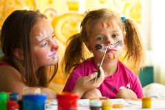 Girls playing with painting Stock Images