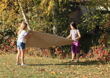 Girls playing with paper Royalty Free Stock Photos