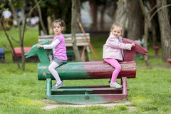 Girls playing in park Stock Images