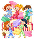 Girls playing pillow fight at slumber party Royalty Free Stock Photo